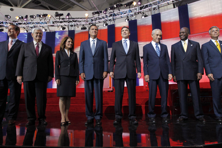 Republican presidential candidates stand together before a Republican presidential candidate debate at the Reagan Library in Simi Valley, Calif on Sept 7, 2011.