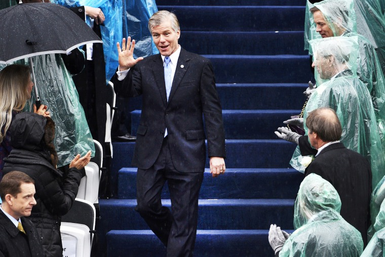 Outgoing Virginia Governor McDonnell waves to guests as he arrives for the swearing-in ceremony of incoming governor McAuliffe in Richmond