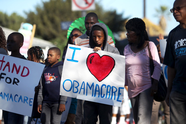 Supporters of the Affordable Care Act march in the 29th annual Kingdom Day Parade in Los Angeles, Jan. 20, 2014.
