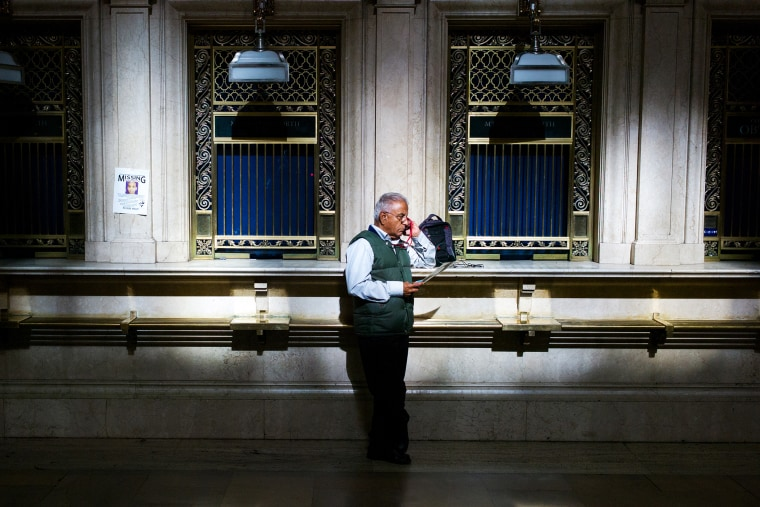 A man speaks on his cell phone in Grand Central Station, Oct. 15, 2013.