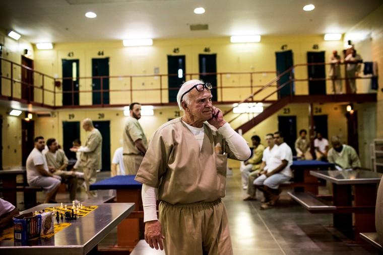 A prisoner at Rhode Island's John J. Moran Medium Security Prison walks through his cell block, Dec. 10, 2013.