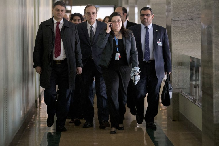 Members of the Syrian National Coalition, Syria's main political opposition group, arrive for a meeting with U.N. mediator Lakhdar Brahimi in Geneva, Switzerland, Jan. 24, 2014.