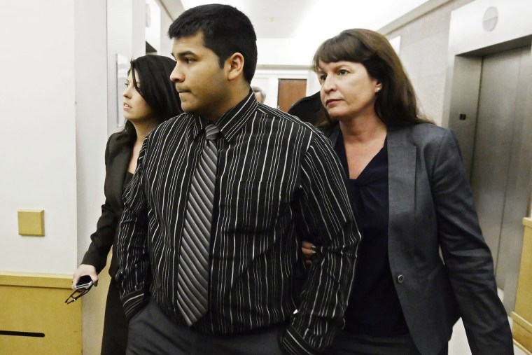 Erick Muñoz, husband of Marlise Muñoz walks into the Tarrant County court house with attorneys in Fort Worth, Texas, USA, Jan. 24, 2014.