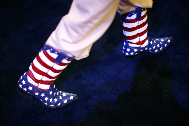 A participant walks the convention floor in Stars and Stripes cowboy boots during the second day of the Republican National Convention, Aug. 28, 2012 in Tampa, Fla.