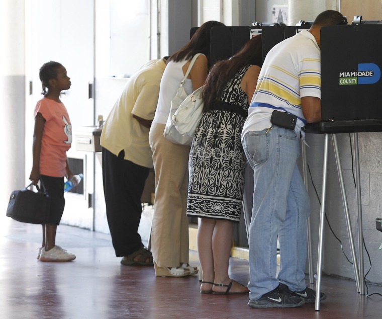 People vote during the U.S. presidential election in North Miami Beach, Florida November 6, 2012.