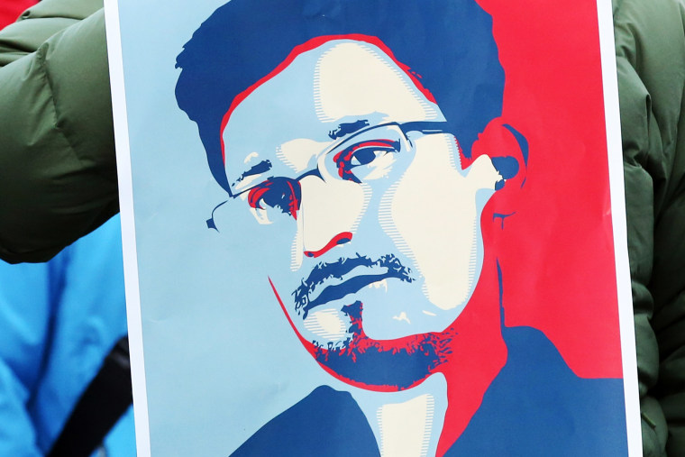 A demonstrator holds a poster of Edward Snowden in Hamburg, Germany, Dec. 28, 2013.