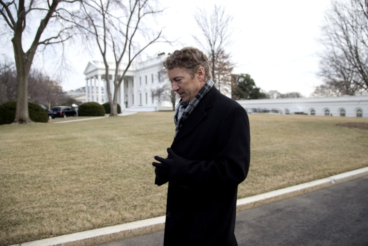 Rand Paul walks from the White House after an event hosted by Barack Obama about the Promise Zones Initiative, Jan. 9, 2014.