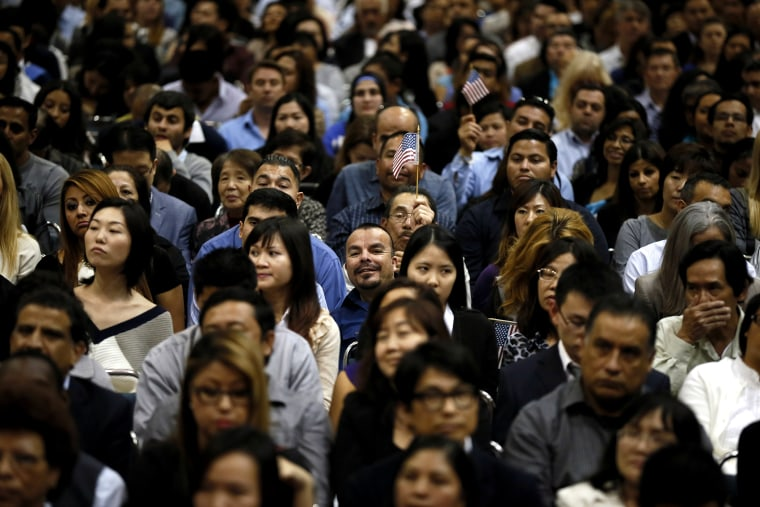 Immigrants take part in a naturalization ceremony for new U.S. citizens in Los Angeles