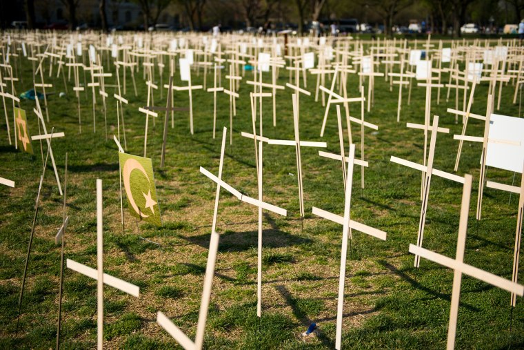 Hundreds of crosses, representing gun deaths since the Newtown, Connecticut elementary shootings, are placed on the National Mall on April 11, 2013 in Washington, DC.