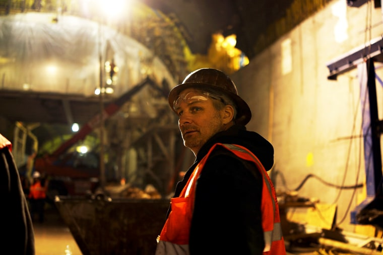 A construction worker pauses at the Second Avenue Subway project site in New York, Jan. 10, 2014.