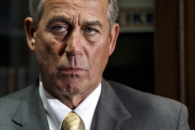 John Boehner meets with reporters at the RNC headquarters in Washington, Jan. 28, 2014.
