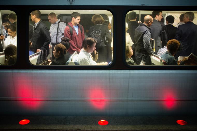 Passengers fill up Washington Metro subway cars in Arlington, Va., Oct. 17, 2013.