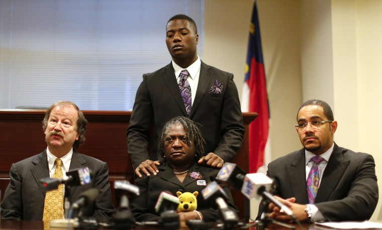 Attorney Charles Monnett (L) speaks regarding Jonathan Ferrell, who was shot and killed in September 2013, as mother Georgia Ferrell (C) look on during a news conference in Charlotte, N.C. Jan. 14, 2014.