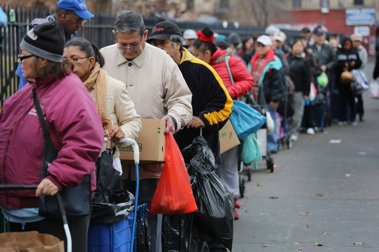 Brooklyn residents receive free food as part of a Bowery Mission outreach program on December 5, 2013 in the Brooklyn borough of New York City.