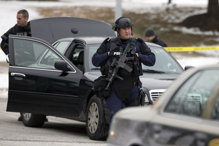 Police walk on the scene after a shooting at The Mall in Columbia on Jan. 25, 2014 in Columbia, Md.