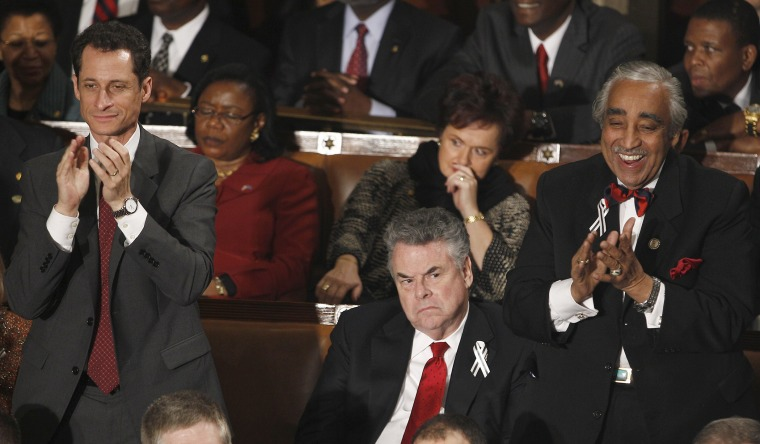 Rep. Anthony Weiner, D-N.Y., left, and Rep. Charles Rangel, D-N.Y., right stand and applaud as Rep. Peter King, R-N.Y. sits during President Barack Obama's State of the Union address in Washington, Tuesday, Jan. 25, 2011.
