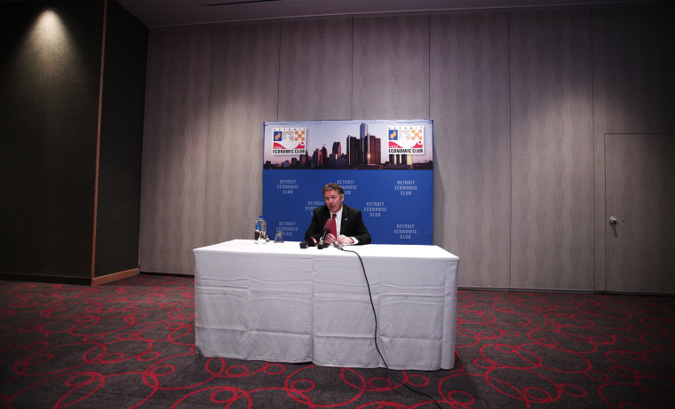 Sen. Rand Paul (R-KY) speaks with the news media after delivering a speech in Detroit, Michigan, December 6, 2013.