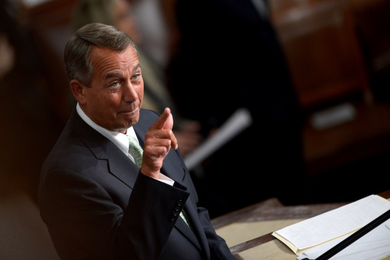 U.S. House Speaker John Boehner gestures before President Barack Obama delivers the State of the Union address on Jan. 28, 2014 at the US Capitol in Washington.