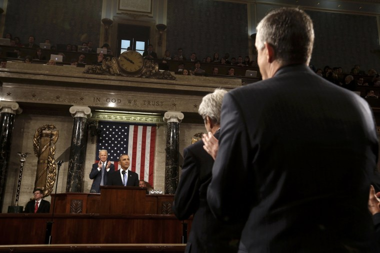 White House Chief of Staff Denis McDonough (R) and Secretary of State John Kerry (2nd R) applaud President Barack Obama as he delivers his State of the Union speech on Capitol Hill in Washington, Jan 28, 2014.