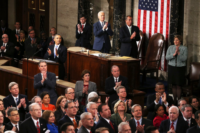 U.S. President Barack Obama and others applaud during the State of the Union, Jan. 28, 2014.