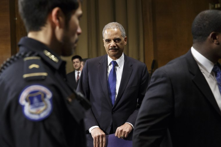 Attorney General Eric Holder arrives to testify before the Senate Judiciary Committee, Jan. 29, 2014.