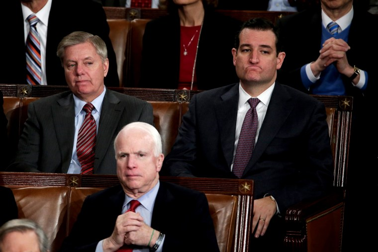 Sen. Lindsey Graham, Sen. John McCain, and Sen. Ted Cruz listen to the State of the Union address, Jan. 28, 2014.