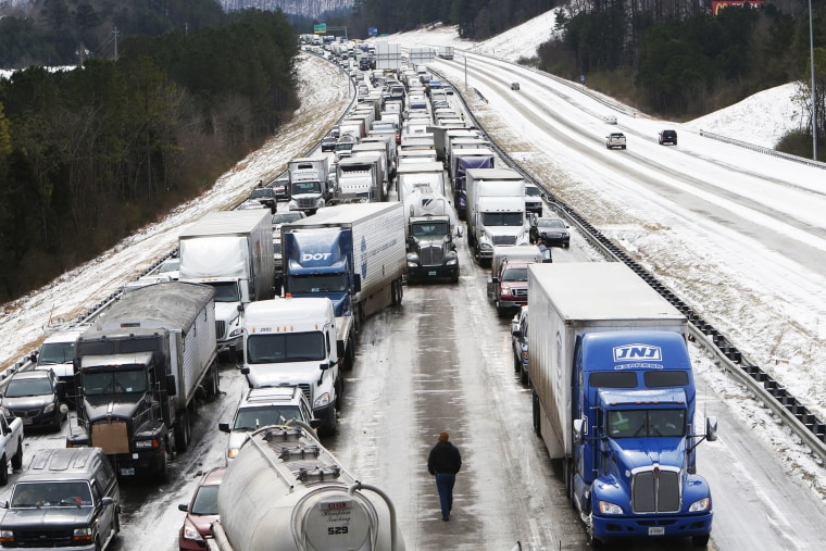 Traffic is at a standstill on Interstate 65 northbound as officials work to clear abandoned vehicles in Hoover, Ala. Jan.  29, 2014.
