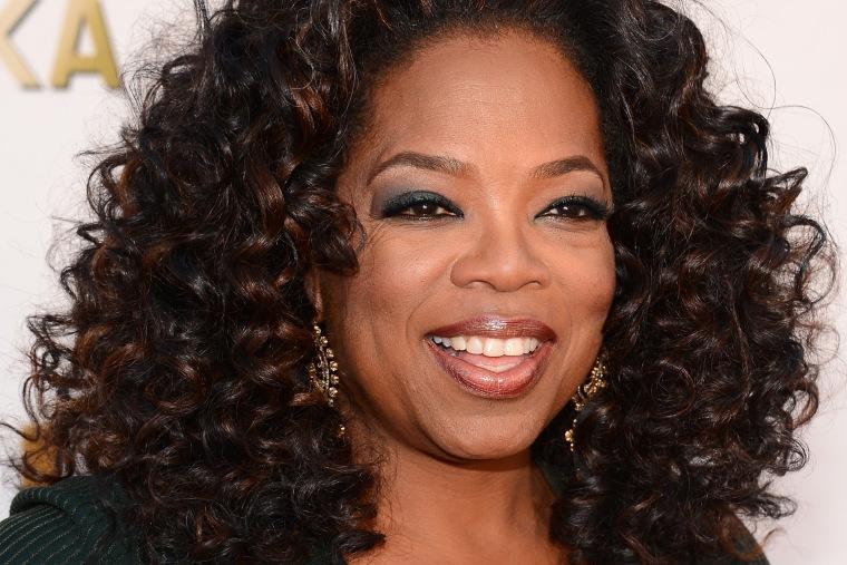 Oprah Winfrey attends the 19th Annual Critics' Choice Movie Awards at Barker Hangar on January 16, 2014 in Santa Monica, California.