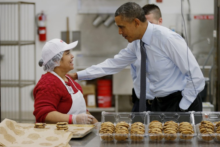 President Barack Obama greets an employee in the bakery at a Costco store in Lanham, Md., Jan. 29, 2014.