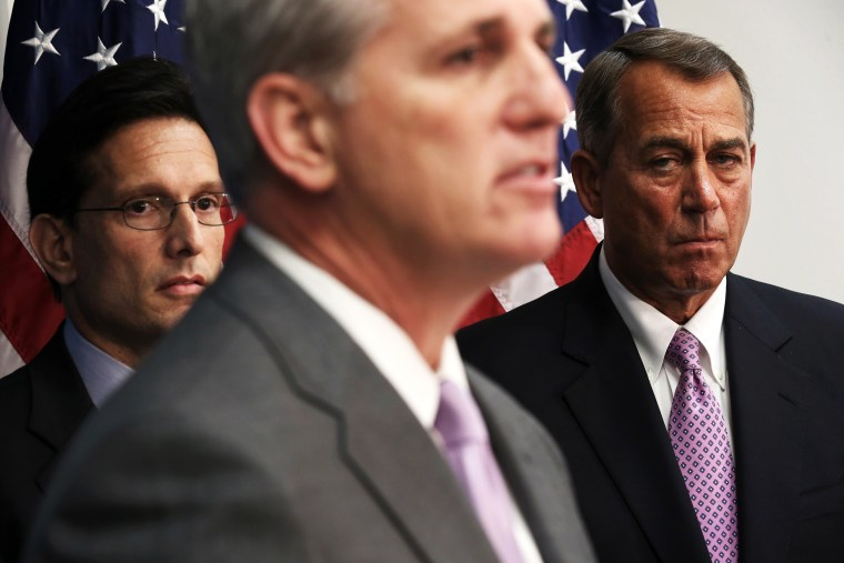 Kevin McCarthy, John Boehner, and Eric Cantor listen during a news briefing on Jan. 14, 2014.