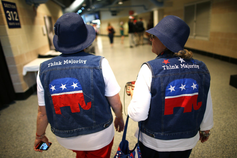 Two attendees wear GOP logo cut-off jean jackets during the third day of the Republican National Convention on Aug. 29, 2012 in Tampa, Florida.