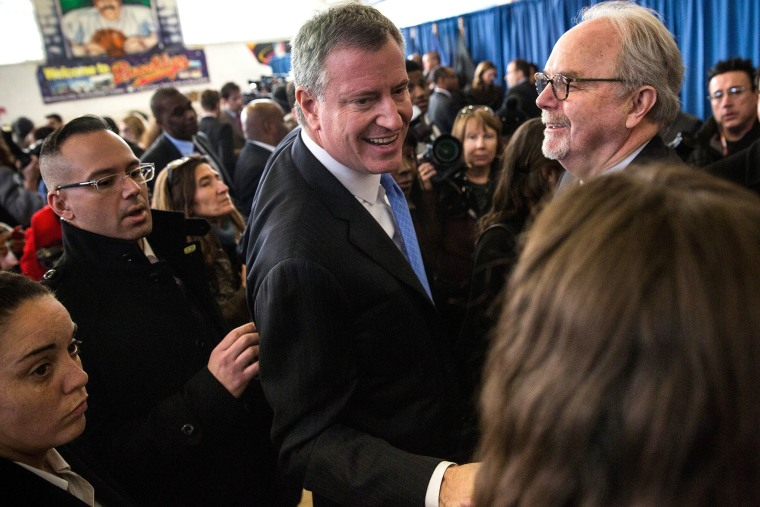 New York City Mayor Bill De Blasio (C) greets supporters after a press conference in Brownsville, Brooklyn, NY on Jan. 30, 2014.