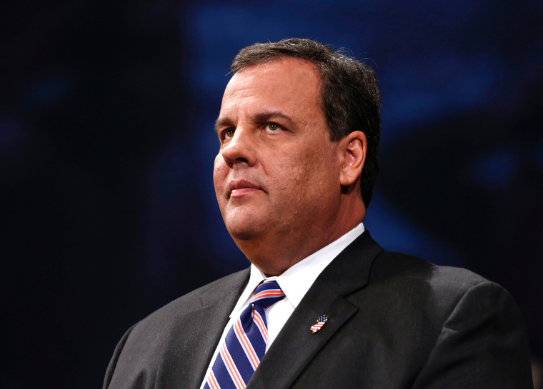 New Jersey Gov. Chris Christie listens after being sworn in for his second term, Jan. 21, 2014, in Trenton, N.J.