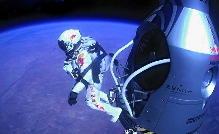 Pilot Felix Baumgartner of Austria jumps out of the capsule during the final manned flight for Red Bull Stratos, Oct. 14, 2012.