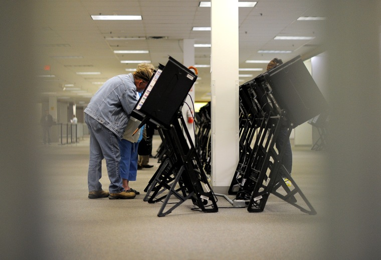 People cast their ballots for the US presidential election at an early voting center, Oct. 15, 2012, in Columbus, Ohio.