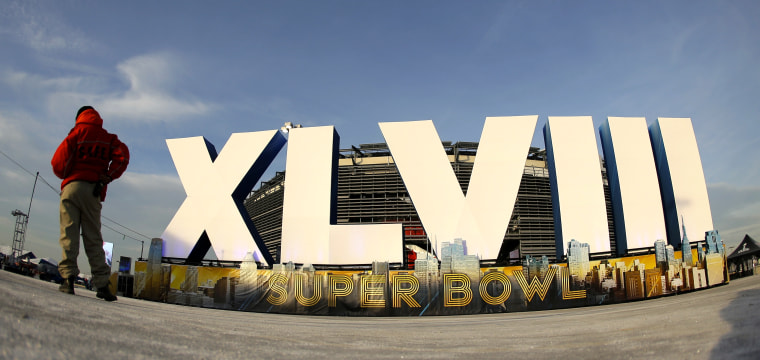 A security guard stands by a  sign for NFL football's Super Bowl XLVIII stands in front of MetLife Stadium Sat. Feb. 1, 2014, in East Ruthoford, N.J. The...