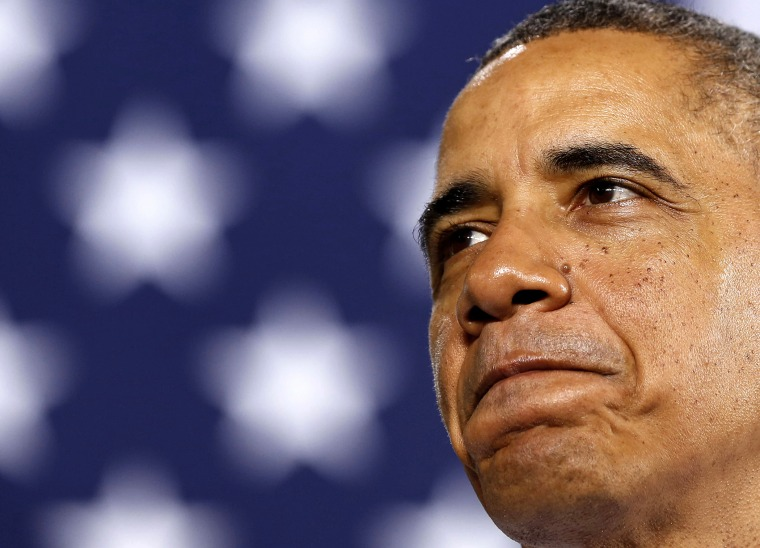 President Barack Obama pauses while he speaks at an event, Jan. 30, 2014 in Waukesha, Wis.