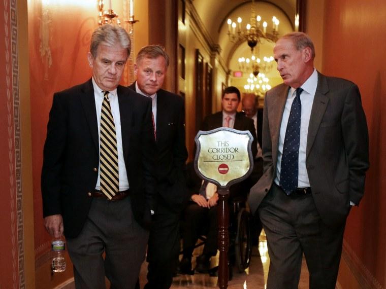 (L-R) Sen. Tom Coburn (R-OK), Sen. Richard Burr (R-NC) and Sen. Dan Coats (R-IN) leave a Republican Senate caucus meeting at the U.S. Capitol September 30, 2013 in Washington, DC.