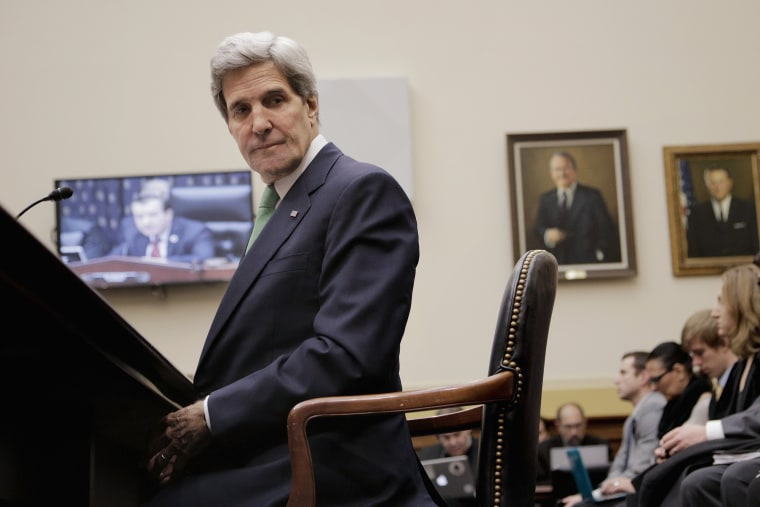 Secretary of State John Kerry waits to testify before the House Foreign Affairs Committee on December 10, 2013 in Washington, D.C.