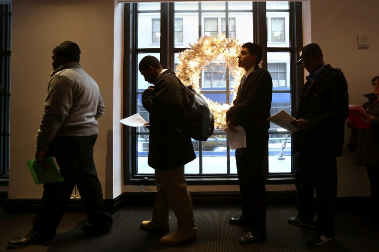Applicants line up to meet potential employers at the Diversity Job Fair, Dec. 6, 2012, in New York, N.Y.