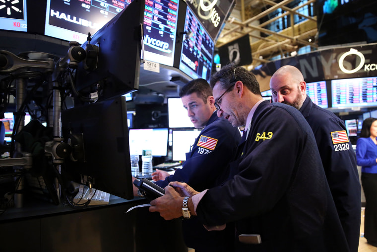 Traders work on the floor of the New York Stock Exchange at the end of the trading day, Feb. 3, 2014 in New York, N.Y.