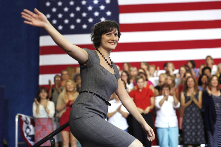Sandra Fluke steps on stage to introduce President Barack Obama during an election campaign rally at the Auraria Event Center in Denver, Colorado, Aug. 8, 2012.