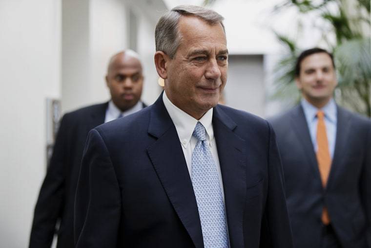 John Boehner smiles as walks to a strategy meeting with fellow Republicans, Feb. 4, 2014.