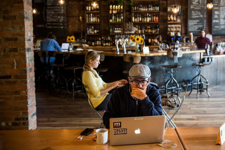 A customer works on his laptop at Great Lakes Coffee Roasting Company in Detroit, Michigan, Sept. 6, 2013.