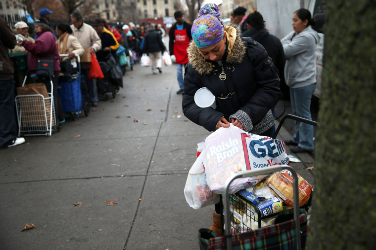 Brooklyn residents receive free food as part of a Bowery Mission outreach program on December 5, 2013.
