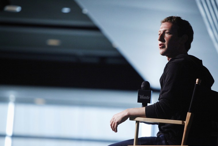 Mark Zuckerberg sits for audience questions during an onstage interview in Washington, Sept. 18, 2013.