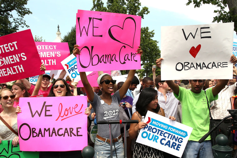 Obamacare supporters react to the  U.S. Supreme Court decision to uphold President Obama's health care law, on June 28, 2012 in Washington, D.C.