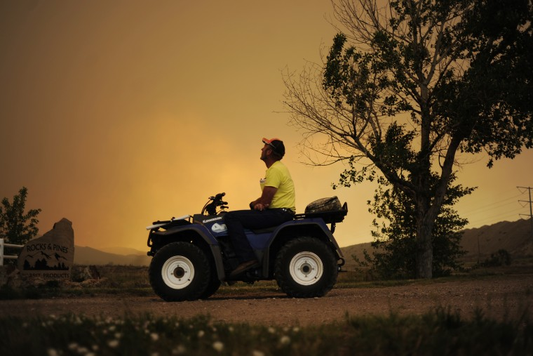 Lon Boehmer watches as the High Park fire burns west of Fort Collins and Loveland on June 10, 2012.