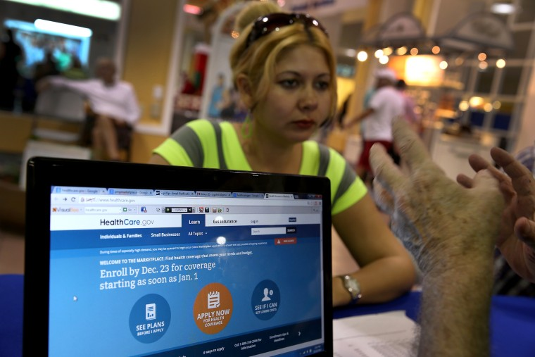 Rocelys Corrales of Miami sits with an insurance agent from Sunshine Life and Health Advisors as she inquires about purchasing health insurance, Dec. 22, 2013.