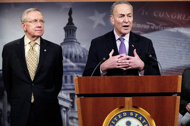 Sen. Chuck Schumer and Senate Majority Leader Harry Reid answer questions during a press conference Jan. 9, 2014.